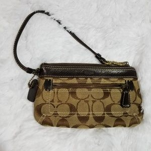 Coach wristlet with outside pocket